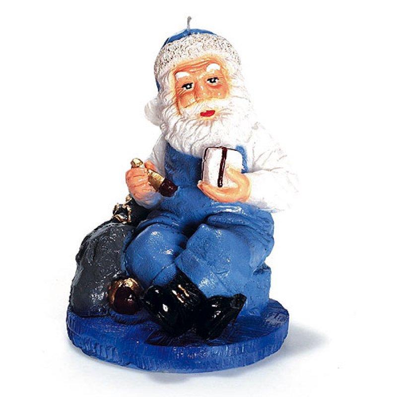 weihnachtsmann sitzend mit geschenk blau kerzen zum. Black Bedroom Furniture Sets. Home Design Ideas